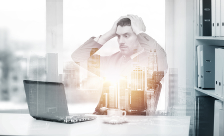 Photo for stressing businessman with laptop at office - Royalty Free Image