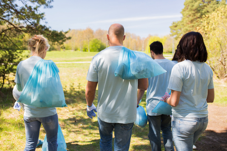 Photo for group of volunteers with garbage bags in park - Royalty Free Image