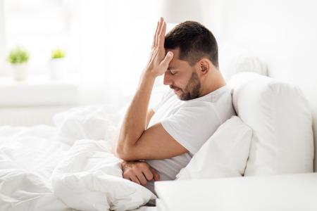 Photo pour stressed man in bed at home - image libre de droit