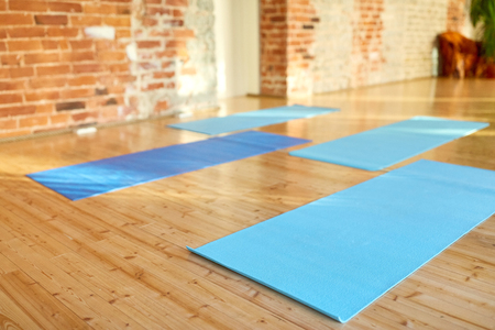 Photo for fitness, sport and healthy lifestyle concept - yoga mats on floor at gym or studio - Royalty Free Image