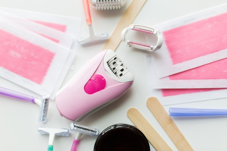 Foto de hair removal wax, epilator and safety razor - Imagen libre de derechos