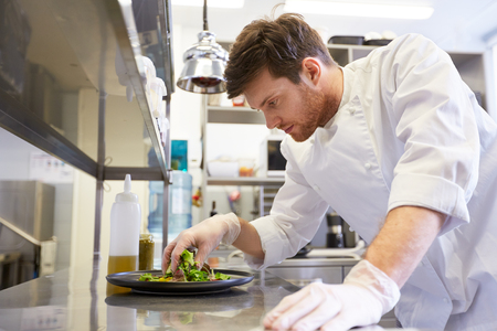 Photo for happy male chef cooking food at restaurant kitchen - Royalty Free Image