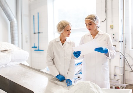 Photo for women technologists working at ice cream factory - Royalty Free Image