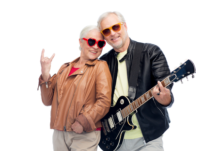 Photo for senior couple with guitar showing rock hand sign - Royalty Free Image