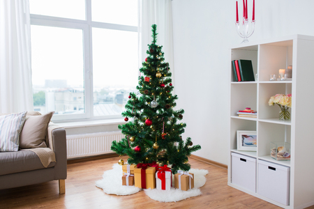 Photo for artificial christmas tree and presents at home - Royalty Free Image