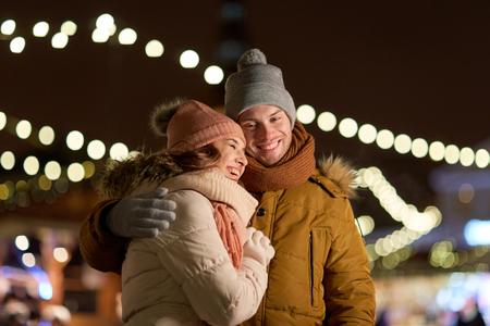 Foto de happy couple hugging at christmas tree - Imagen libre de derechos