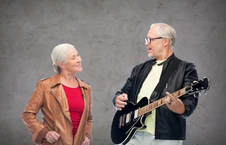 Photo for happy senior couple with electric guitar - Royalty Free Image