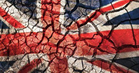 Foto de flag of great britain on cracked ground background - Imagen libre de derechos