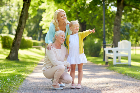 Photo pour happy mother, daughter and grandmother at park - image libre de droit