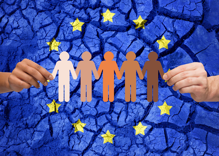 Photo for hands holding chain of people over flag of europe - Royalty Free Image
