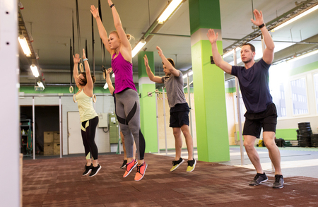 Photo for group of people exercising and jumping in gym - Royalty Free Image