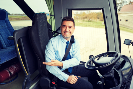 Foto per happy driver inviting on board of intercity bus - Immagine Royalty Free