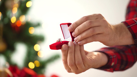 Photo for close up of hands with ring in christmas gift box - Royalty Free Image