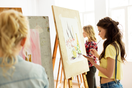 Photo for woman with easel painting at art school studio - Royalty Free Image