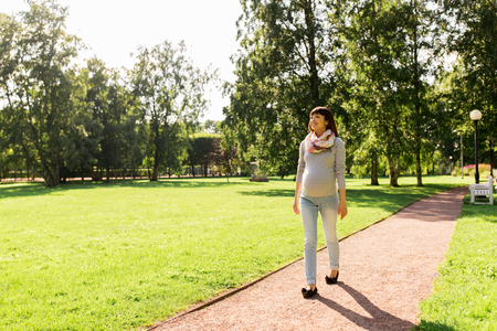 Photo for happy pregnant asian woman walking at park - Royalty Free Image