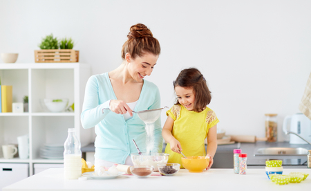 Photo for happy mother and daughter baking at home - Royalty Free Image