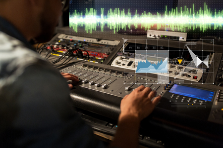Photo for sound engineer at recording studio mixing console - Royalty Free Image