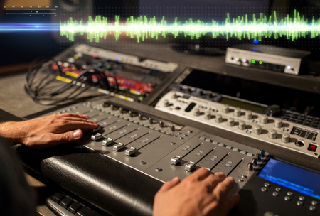 Photo for hands on mixing console at sound recording studio - Royalty Free Image