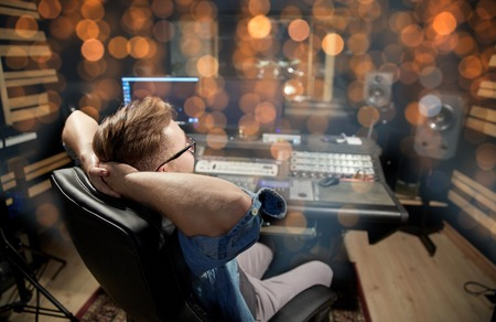 Photo for man at mixing console in music recording studio - Royalty Free Image