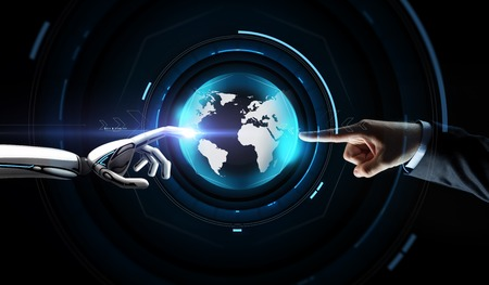 Photo pour future technology, business and artificial intelligence concept - close up of businessman and robot hand touching virtual earth hologram over black background - image libre de droit