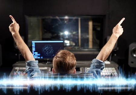 Photo pour music, technology and people concept - man at mixing console in sound recording studio - image libre de droit