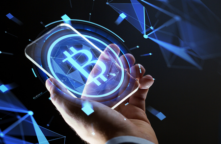 Photo pour close up of hand with smartphone and bitcoin - image libre de droit