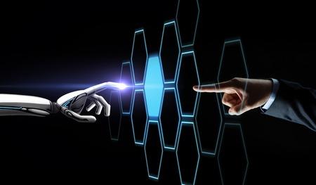 Photo pour robot and human hand touching network hologram - image libre de droit