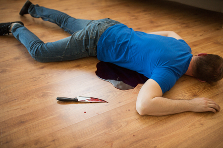 Photo for murder, kill and people concept - dead man body and knife in blood lying on floor at crime scene (staged photo) - Royalty Free Image