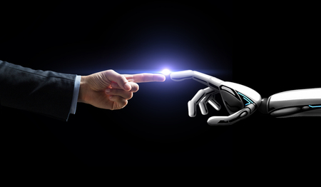 Photo for robot and human hand flash light over black - Royalty Free Image