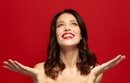Foto de beautiful smiling young woman with red lipstick - Imagen libre de derechos