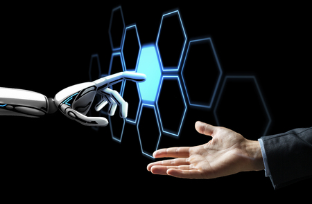 Photo pour human hand and robot touching network hologram - image libre de droit