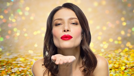 Photo pour beautiful woman with red lipstick blowing air kiss - image libre de droit