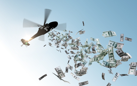 Photo for helicopter dropping money in sky - Royalty Free Image