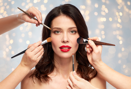 Photo pour woman and hands of make up artists with brushes - image libre de droit