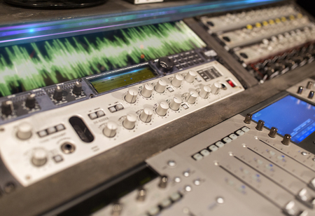 Foto de music mixing console at sound recording studio - Imagen libre de derechos