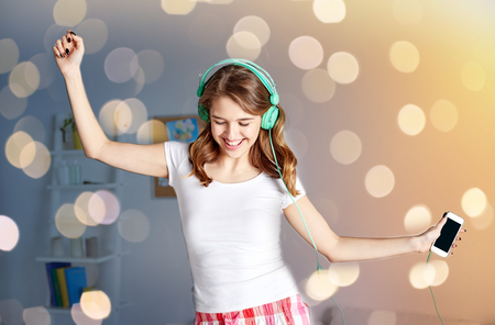 Foto de happy woman in headphones ihaving fun at home - Imagen libre de derechos