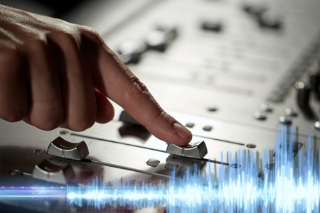 Photo for hand using mixing console for music recording - Royalty Free Image