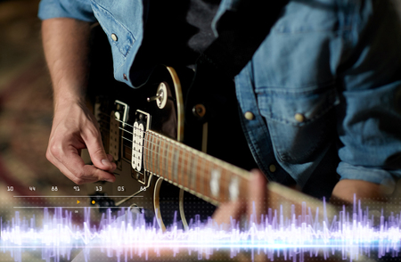 Photo for close up of man playing guitar at studio rehearsal - Royalty Free Image