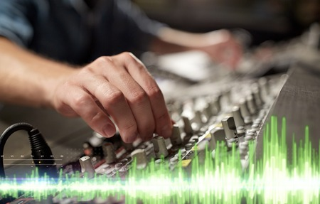 Photo for hands on mixing console in music recording studio - Royalty Free Image