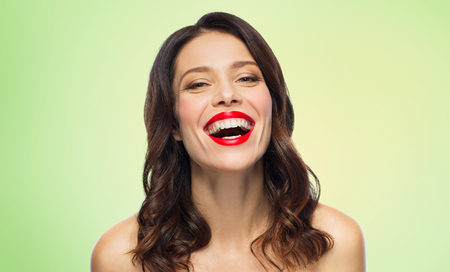 Photo pour beautiful laughing young woman with red lipstick - image libre de droit