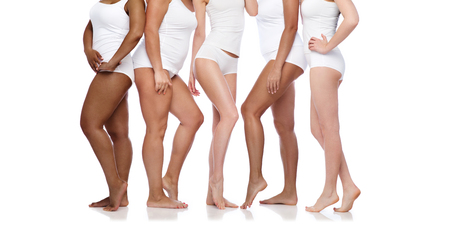 Photo pour group of happy diverse women in white underwear - image libre de droit
