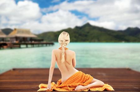 Foto de woman with towel over exotic resort background - Imagen libre de derechos