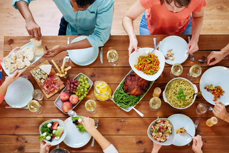 Foto de group of people eating at table with food - Imagen libre de derechos