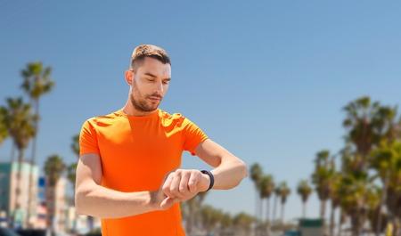 Foto de man with fitness tracker training outdoors - Imagen libre de derechos