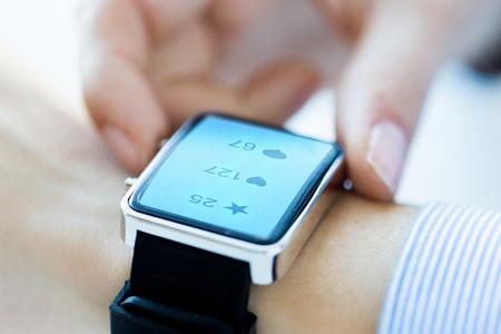 Photo pour close up of smart watch with social media icons - image libre de droit