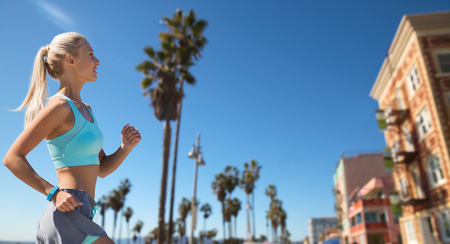 Foto de woman with fitness tracker running - Imagen libre de derechos