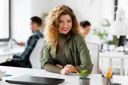 Foto de creative woman working on user interface at office - Imagen libre de derechos