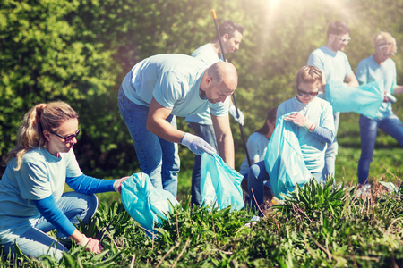 Photo for volunteers with garbage bags cleaning park area - Royalty Free Image