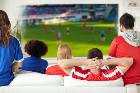 Photo pour friends or football fans watching soccer at home - image libre de droit