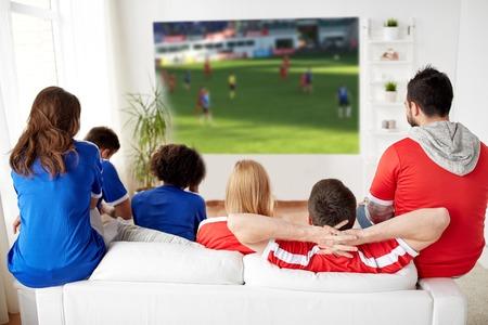 Foto de friends or football fans watching soccer at home - Imagen libre de derechos